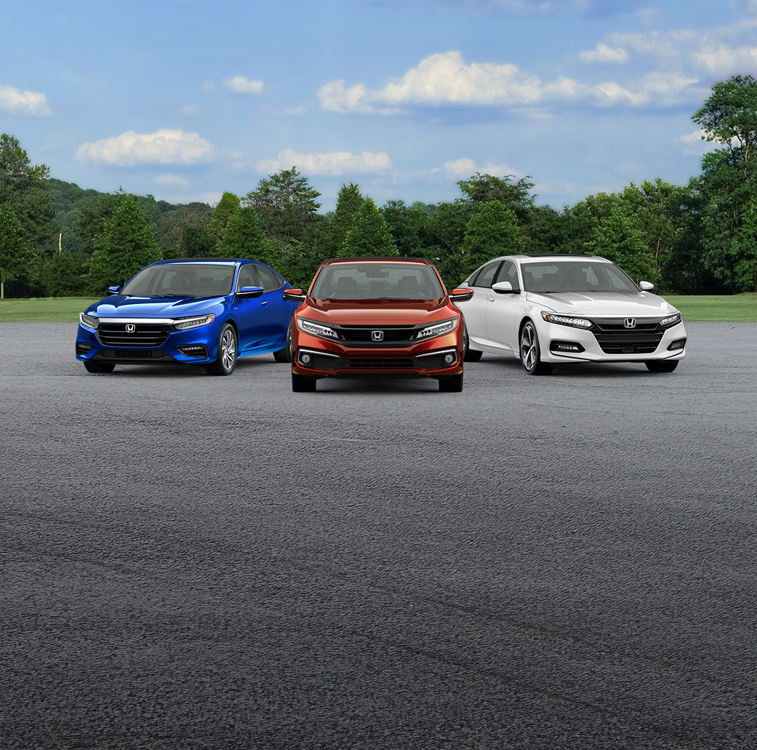 A front-facing view of five Honda vehicles: the HR-V in Lunar Silver Metallic, the Insight in Aegean Blue Metallic, the Civic Sedan in Molten Lava Pearl, the Accord Sedan in Platinum White Pearl, and the CR-V in Radiant Red Metallic.