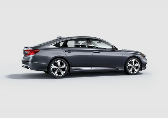 Side passenger profile view of the 2019 Honda Accord Touring 2.0T in Modern Steel Metallic.