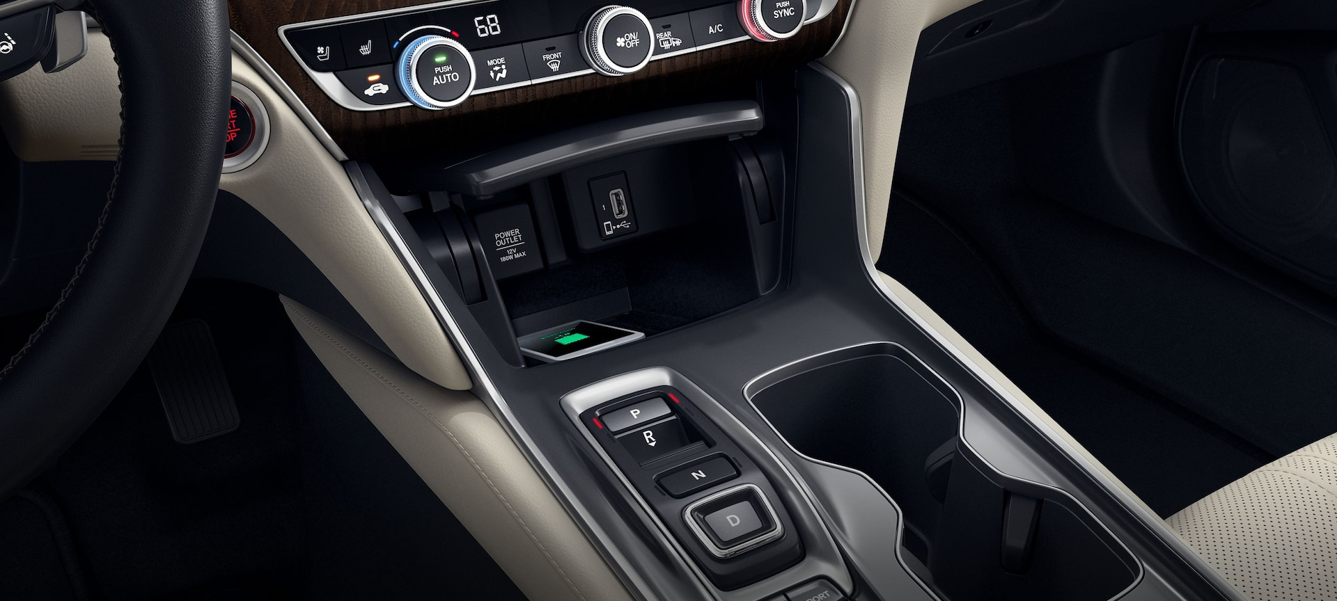Detail of wireless phone charger in center console storage in the 2019 Honda Accord.