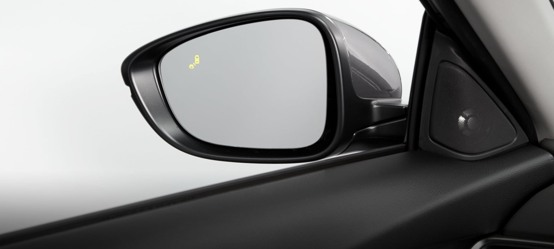 Detail of Blind Spot Information system warning icon on side mirror in the 2019 Honda Accord.
