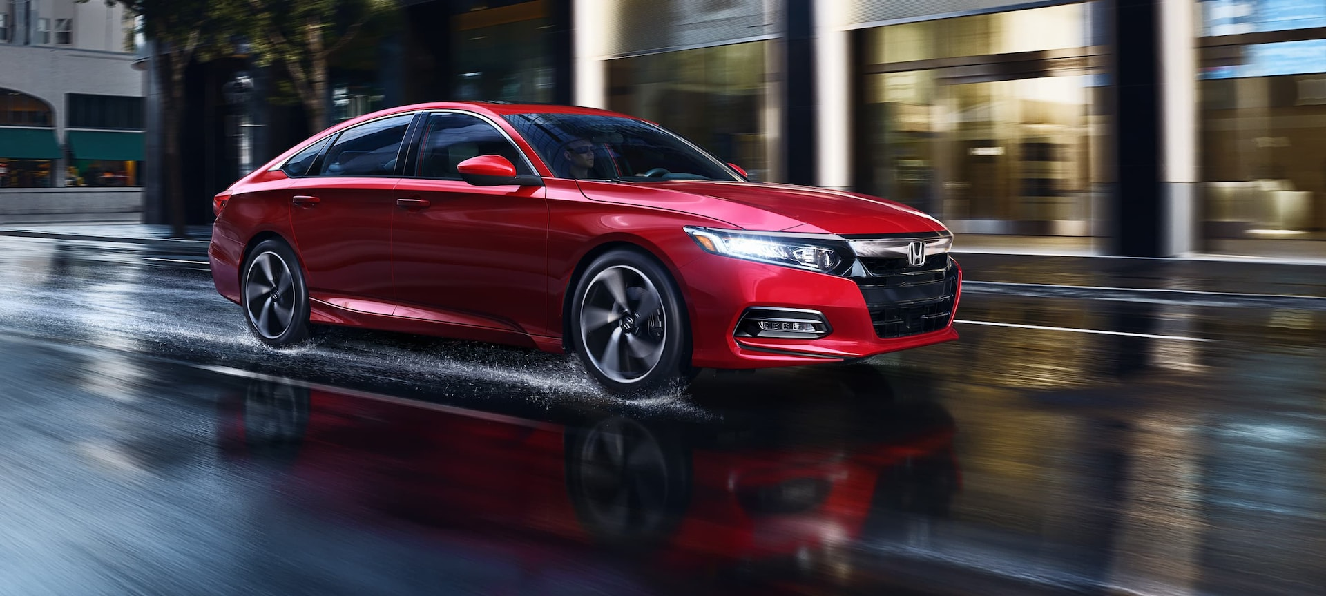 Front 3/4 of 2019 Honda Accord Sport 2.0T in San Marino Red driving in rain.