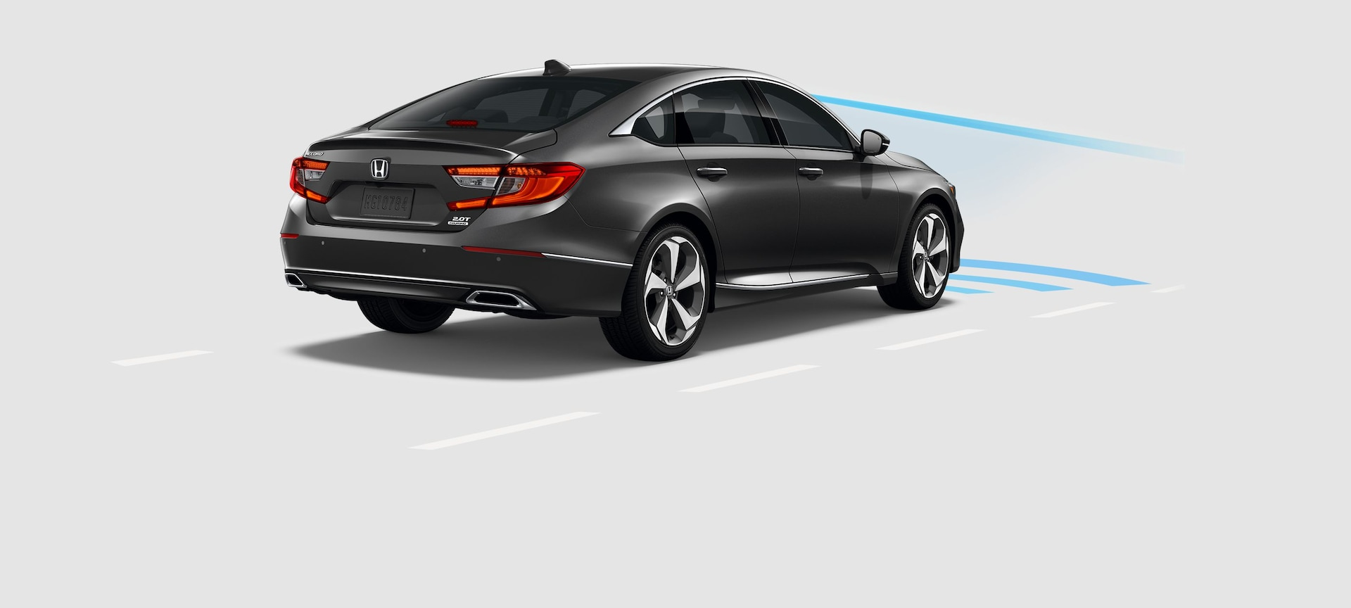 Rear 3/4 of 2019 Honda Accord with demonstration of Collision Mitigation Braking System™.