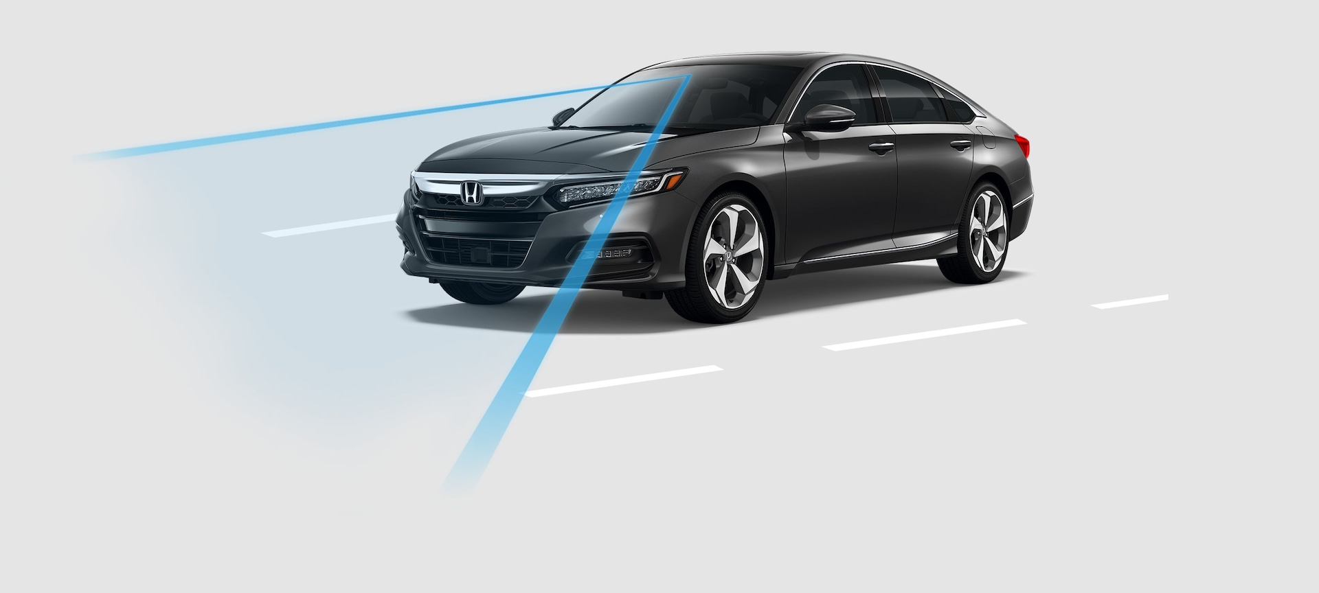 Front 3/4 of 2019 Honda Accord with demonstration of Road Departure Mitigation System (RDM).