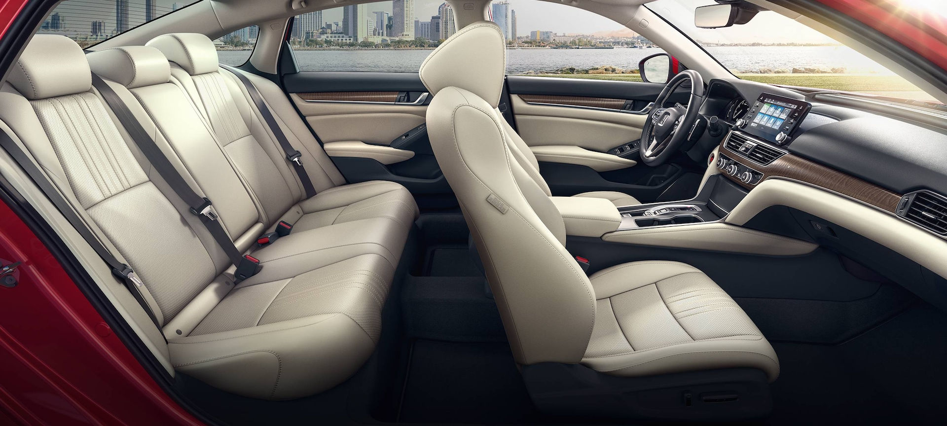 Side profile interior of 2019 Honda Accord Touring 2.0T shown in Radiant Red Metallic with Ivory Leather interior.