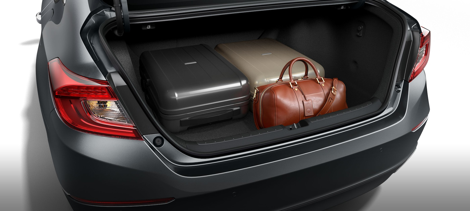 Detail of trunk open with variety of cargo loaded inside the 2019 Honda Accord.