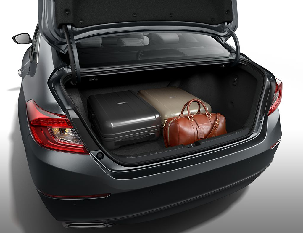 Detail of trunk open with variety of cargo loaded inside in the 2019 Honda Accord Hybrid Touring in Champagne Frost Pearl.