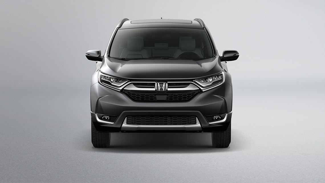 Front view of 2019 Honda CR-V Touring in Gunmetal Metallic showing full LED headlights with auto-on/off.