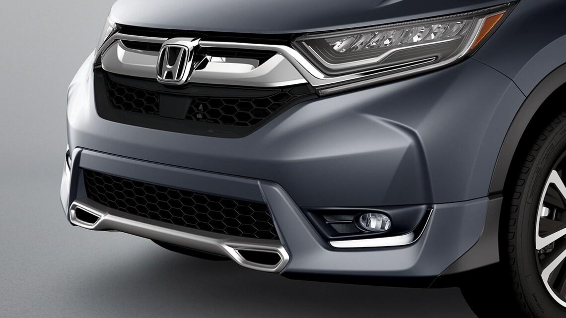 Se muestra la Honda CR-V2019 con accesorio de paragolpes deportivo delantero original de Honda.