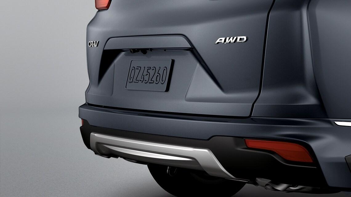 Se muestra la Honda CR-V2019 con accesorio de paragolpes deportivo trasero original de Honda.