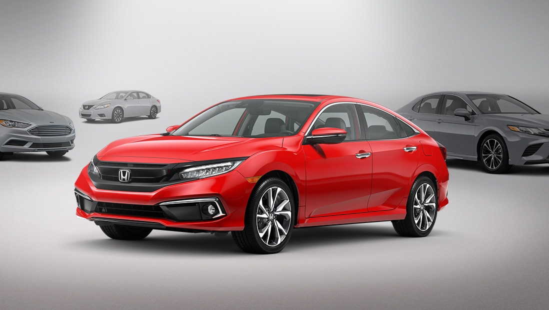 Front 3/4 driver's side view of 2019 Honda Civic Touring Sedan in Rallye Red.