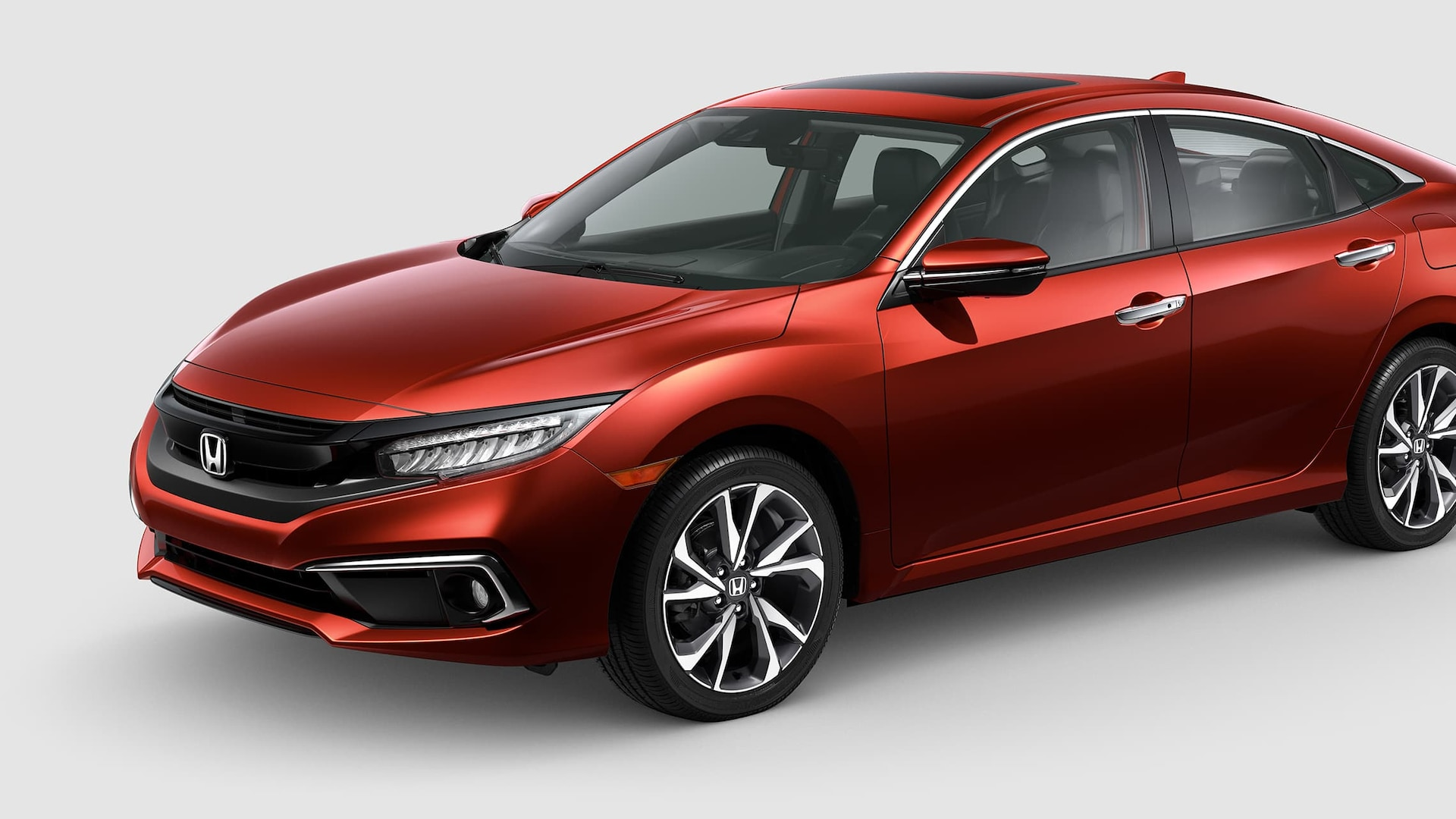 Front 3/4 driver's side view of 2019 Honda Civic Touring Sedan in Molten Lava Pearl.
