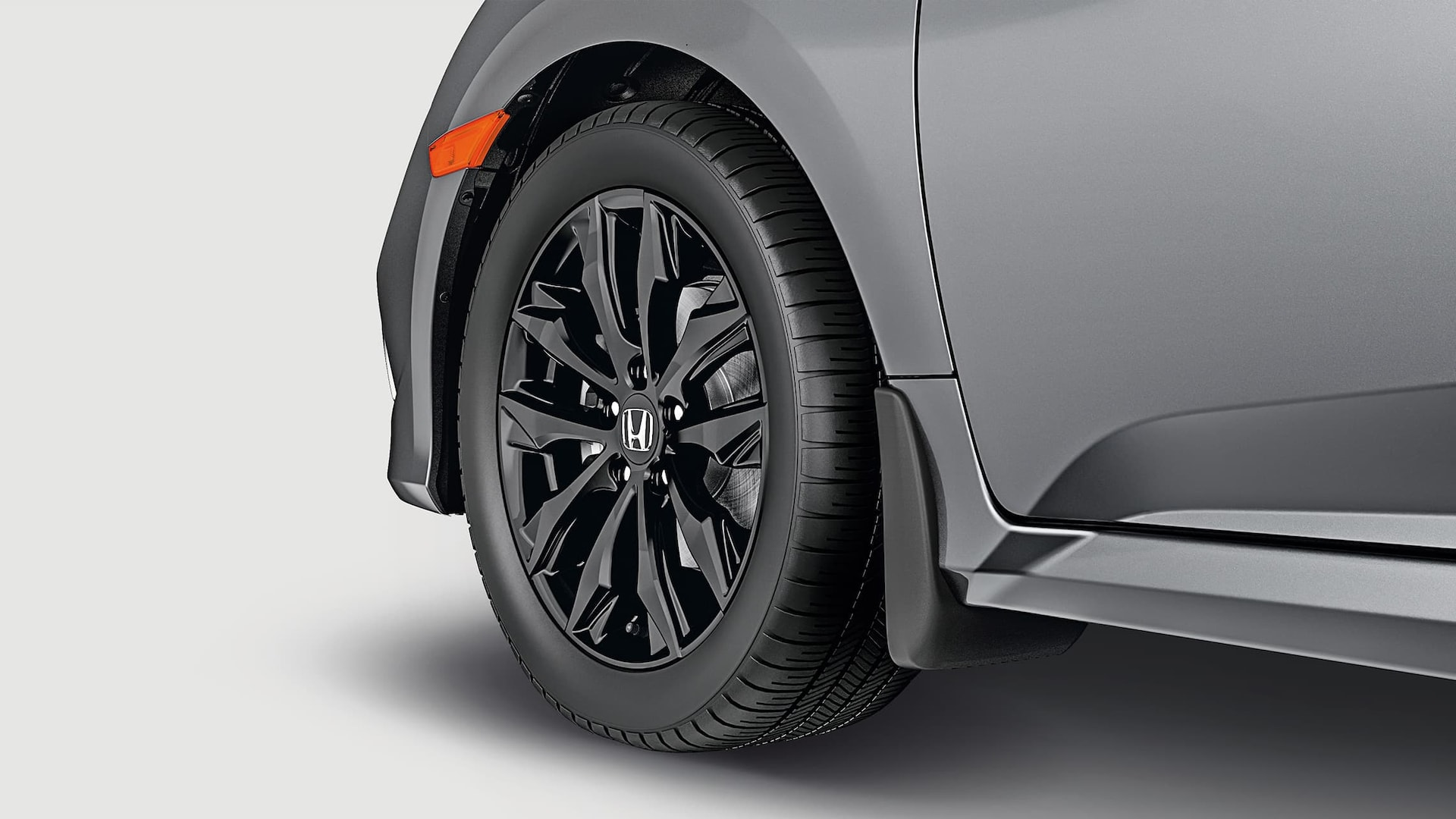 17-inch black alloy wheel detail on the 2020 Honda Civic Sedan in Modern Steel Metallic.