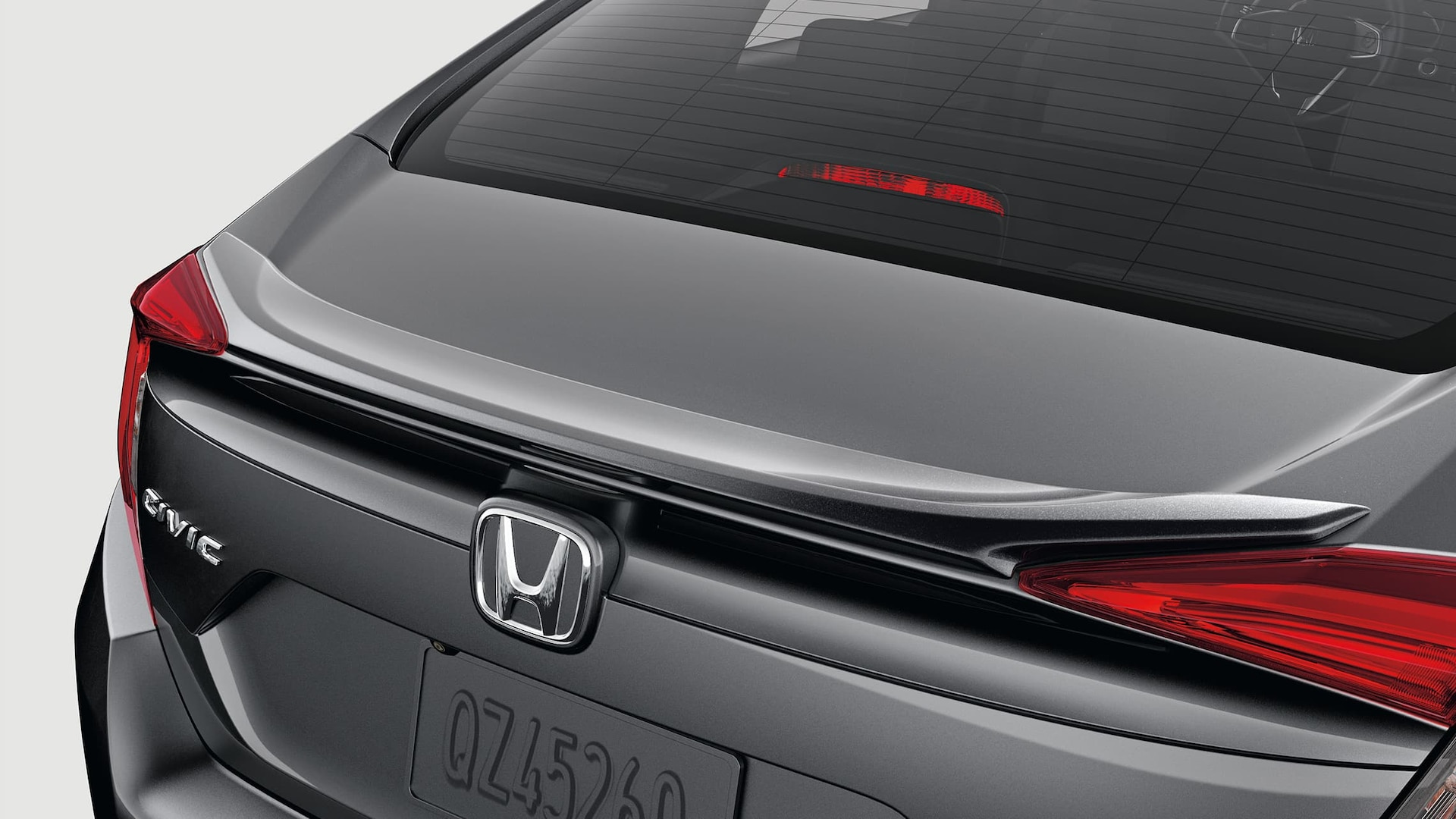Decklid spoiler detail on the 2020 Honda Civic Touring Sedan in Modern Steel Metallic.