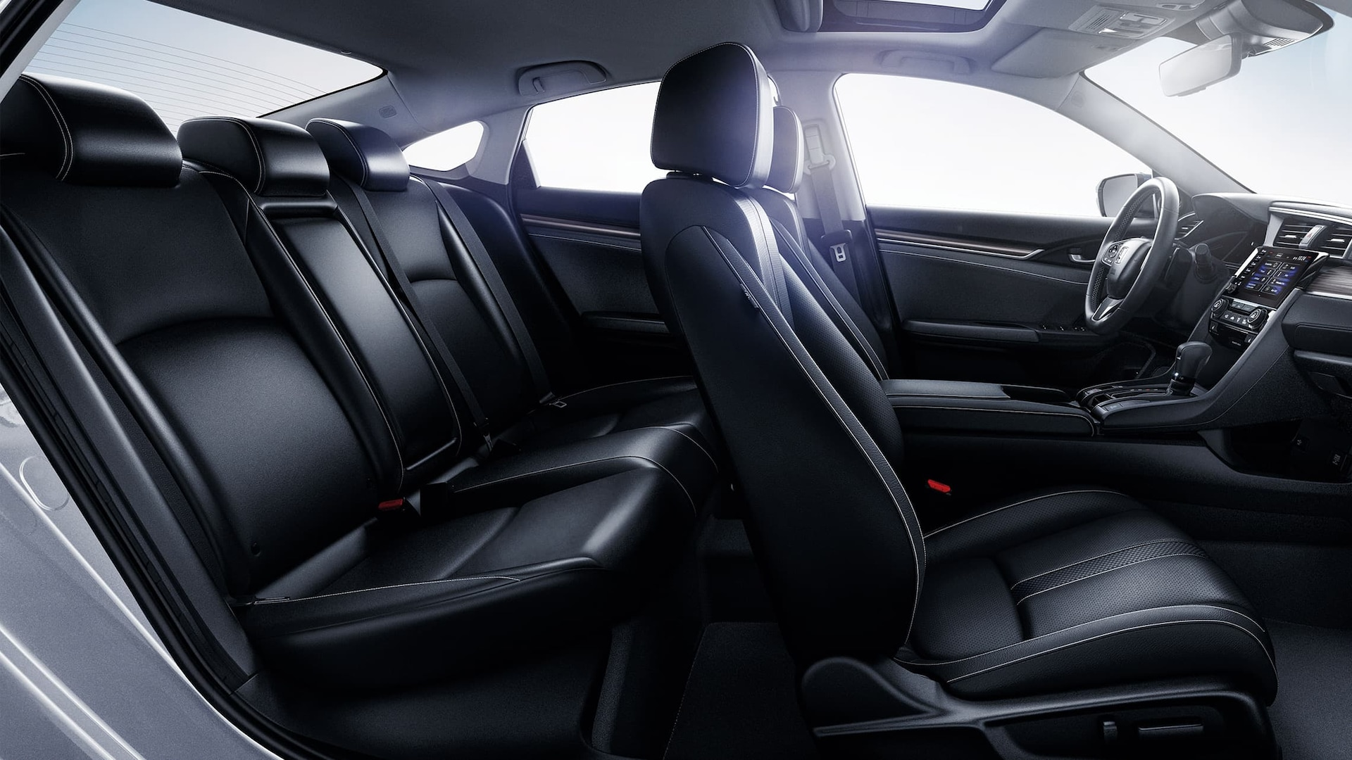 Passenger-side interior view of the 2020 Honda Civic Touring Sedan with Black Leather.