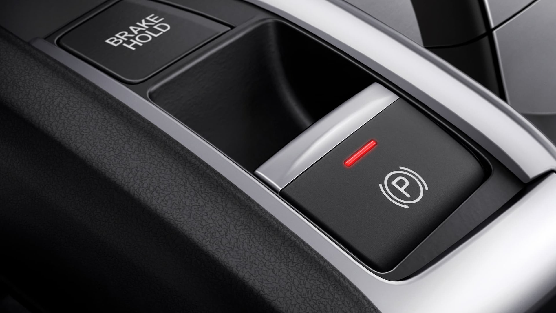 Electric Parking Brake button detail in the 2020 Honda Civic Sedan.