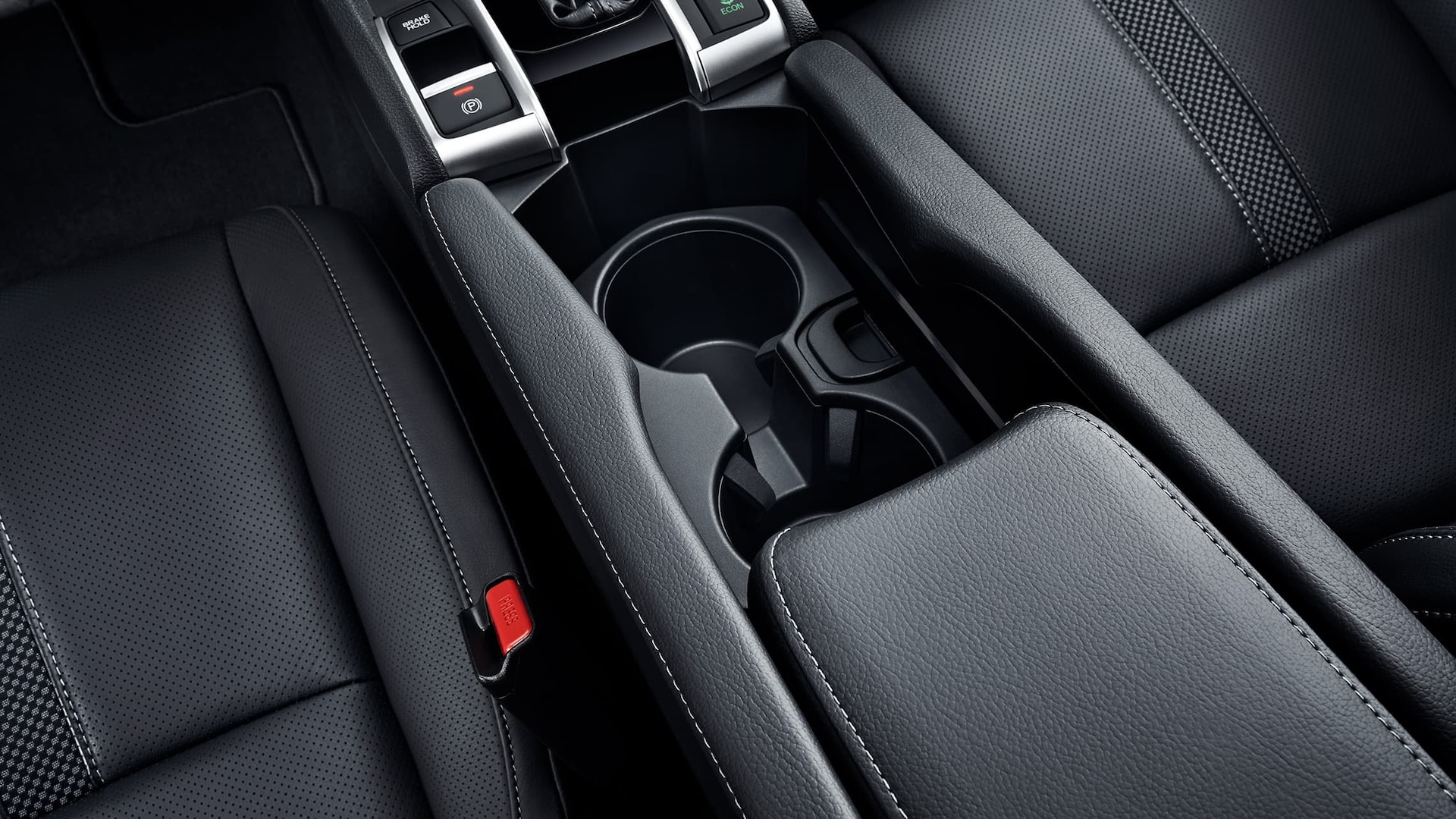 Detail of center console and beverage holders in the 2020 Honda Civic Touring Sedan.