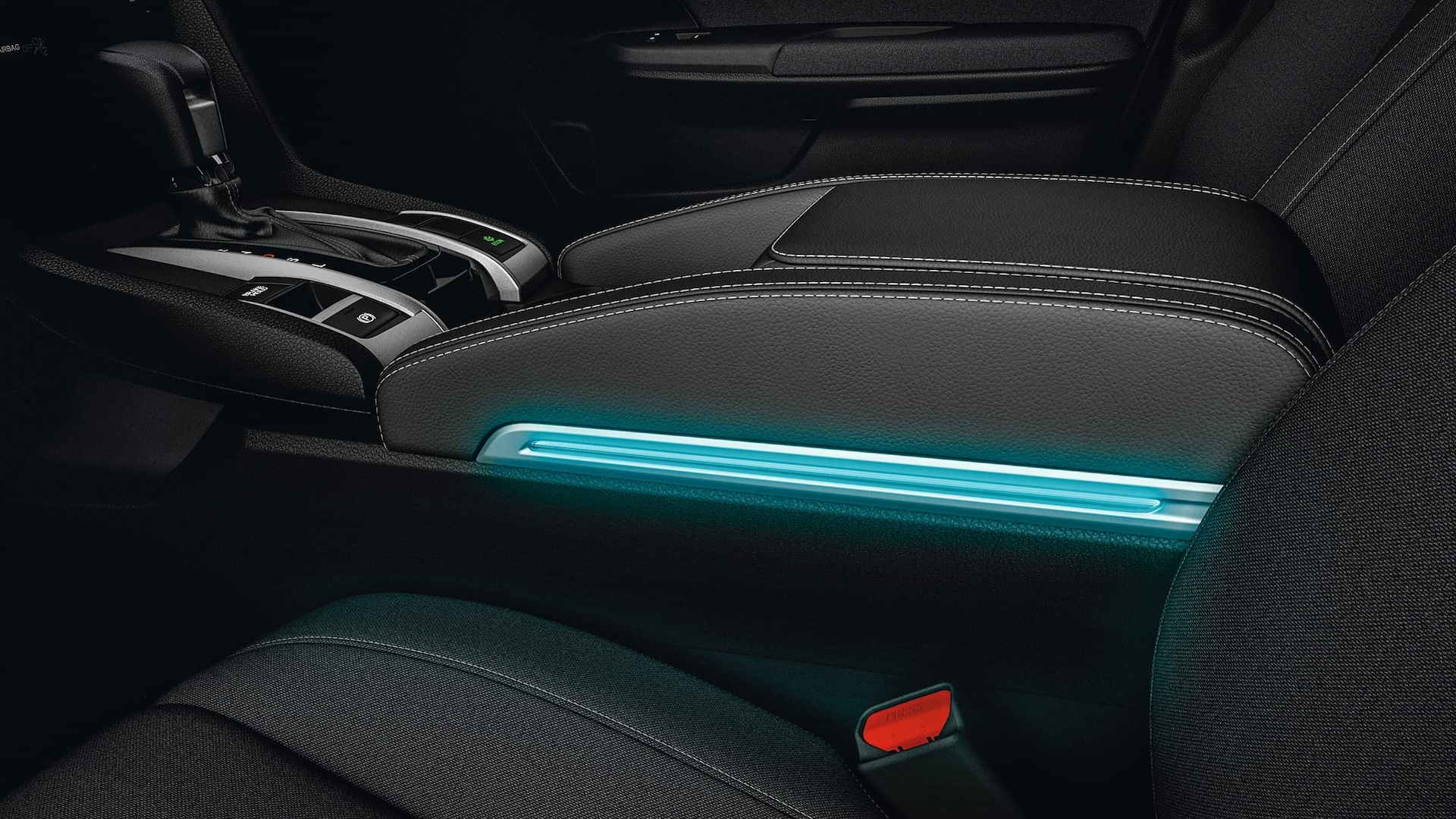 Illuminated armrest detail in the 2020 Honda Civic Sedan.