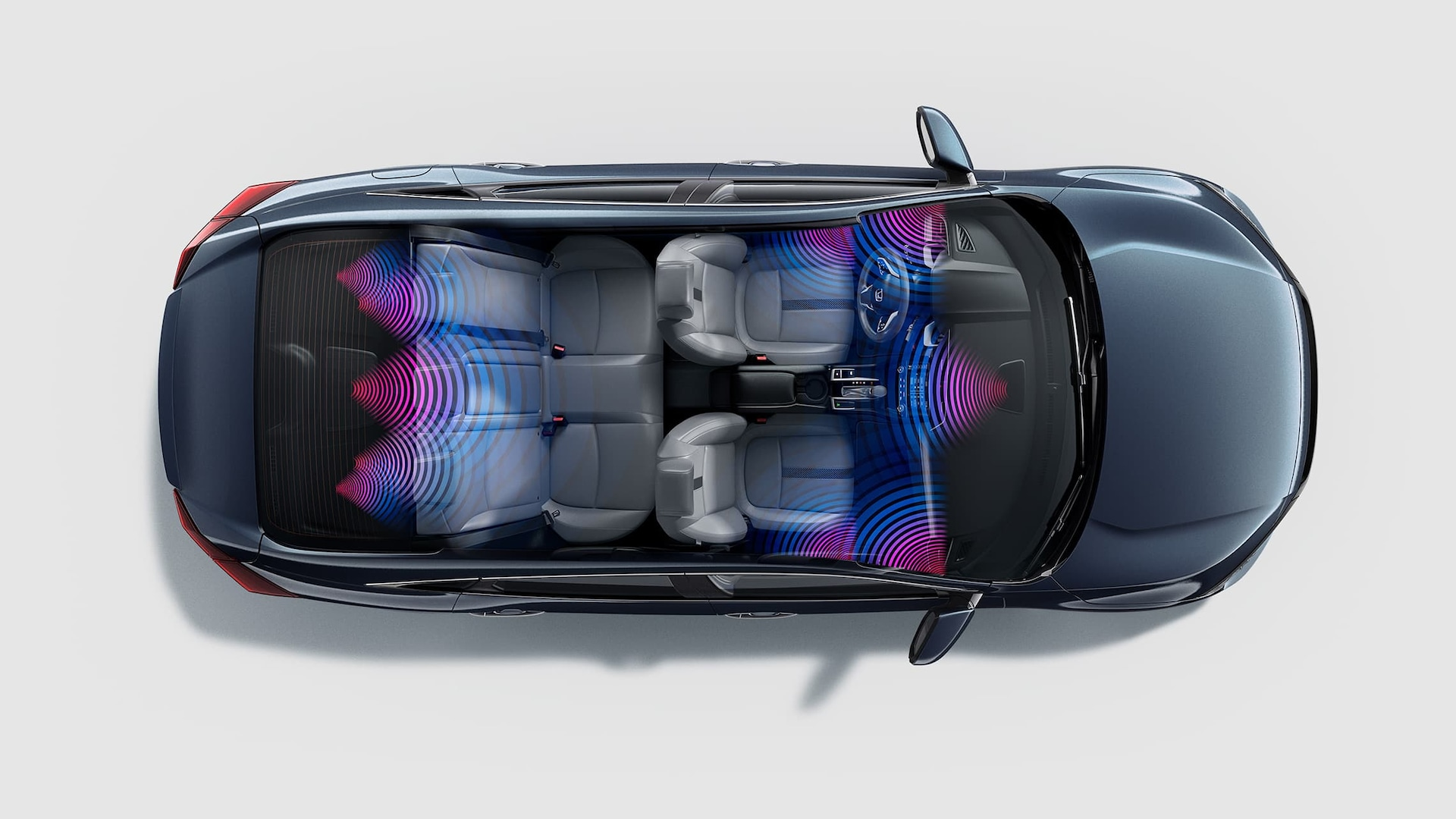 Overhead view of the 2020 Honda Civic Touring Sedan in Cosmic Blue Metallic with illustrated audio sound waves.