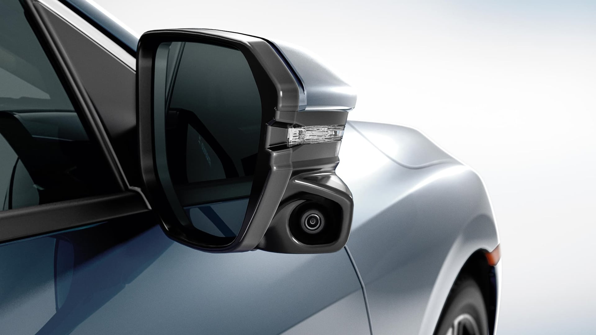 Honda LaneWatch™ camera detail on passenger's side mirror on 2019 Honda Civic Touring Sedan in Cosmic Blue Metallic.