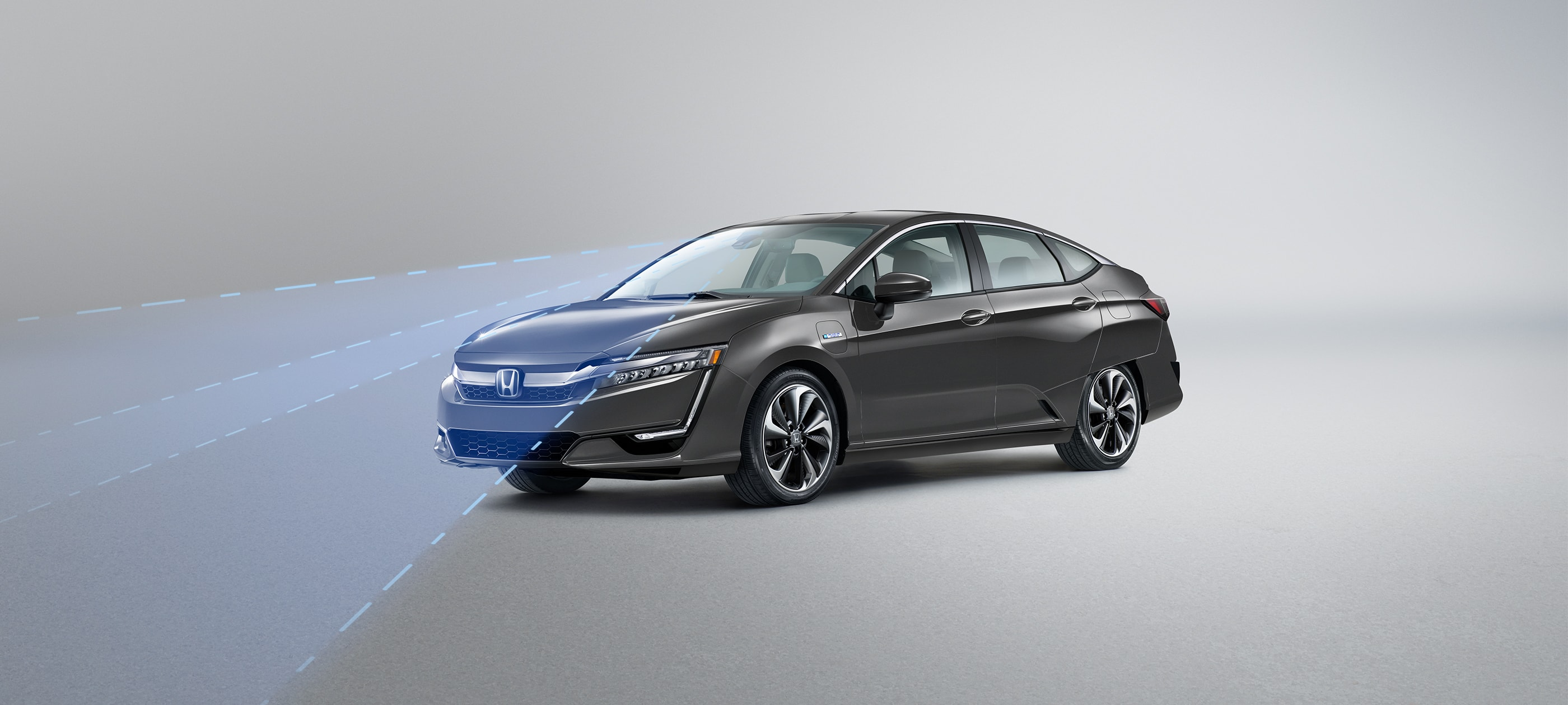 Front ¾ driver-side view of 2019 Honda Clarity PHEV in Modern Steel Metallic with Honda Sensing® illustrated demonstration.