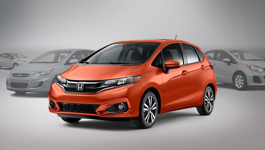 Front driver-side view of the 2020 Honda Fit in Orange Fury.