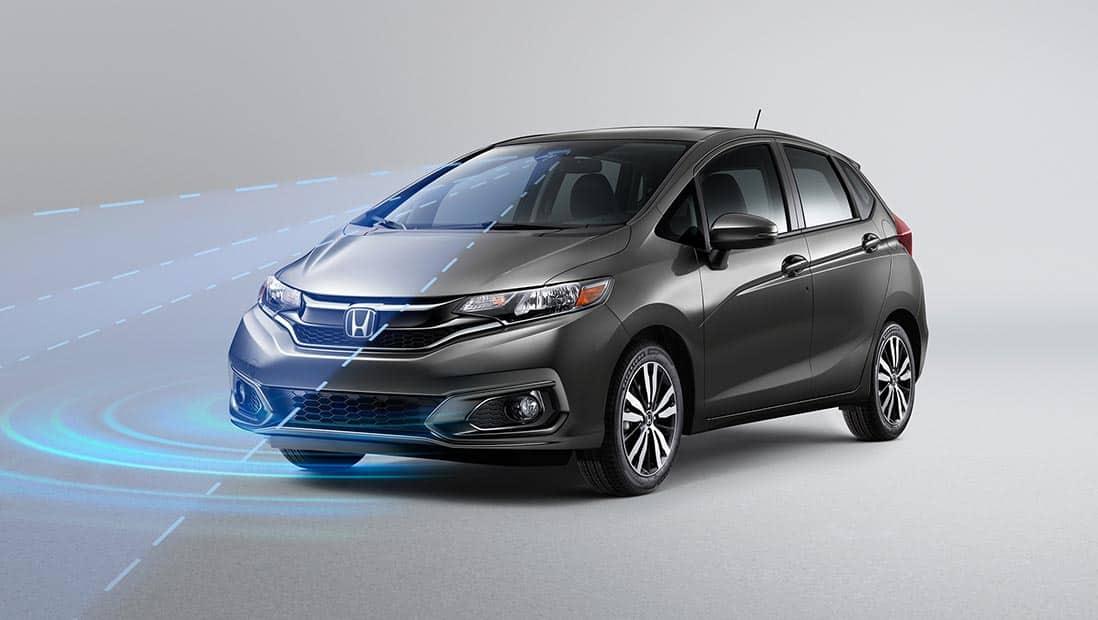 Demostración ilustrada de Honda Sensing® en el Honda Fit EX-L2020 en Modern Steel Metallic.