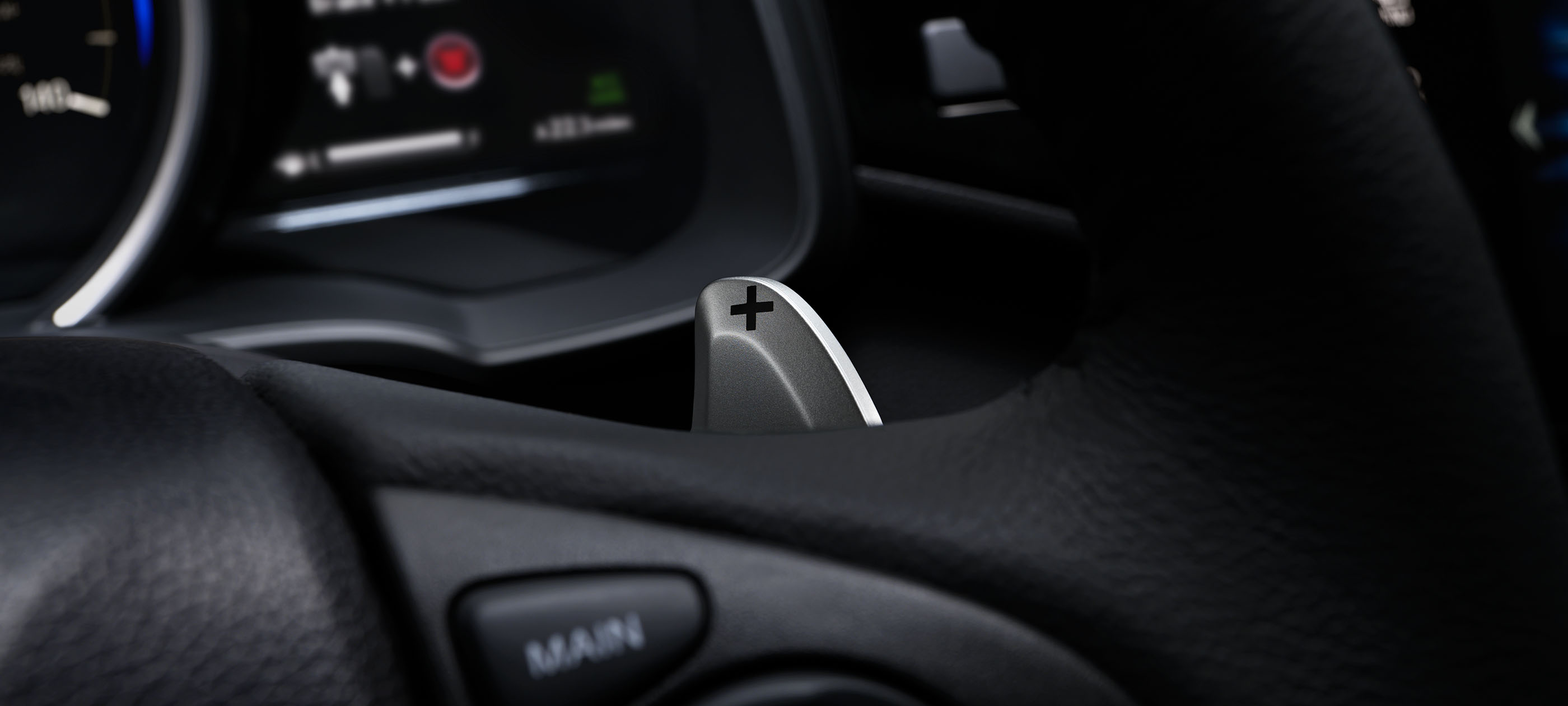 Sport mode with paddle shifters detail on 2019 Honda Fit EX-L with black interior.