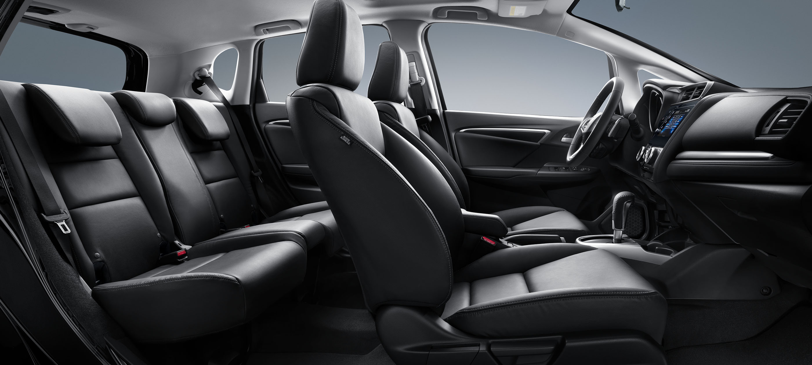 Interior passenger-side profile view of 2019 Honda Fit Sport CVT with black leather interior.