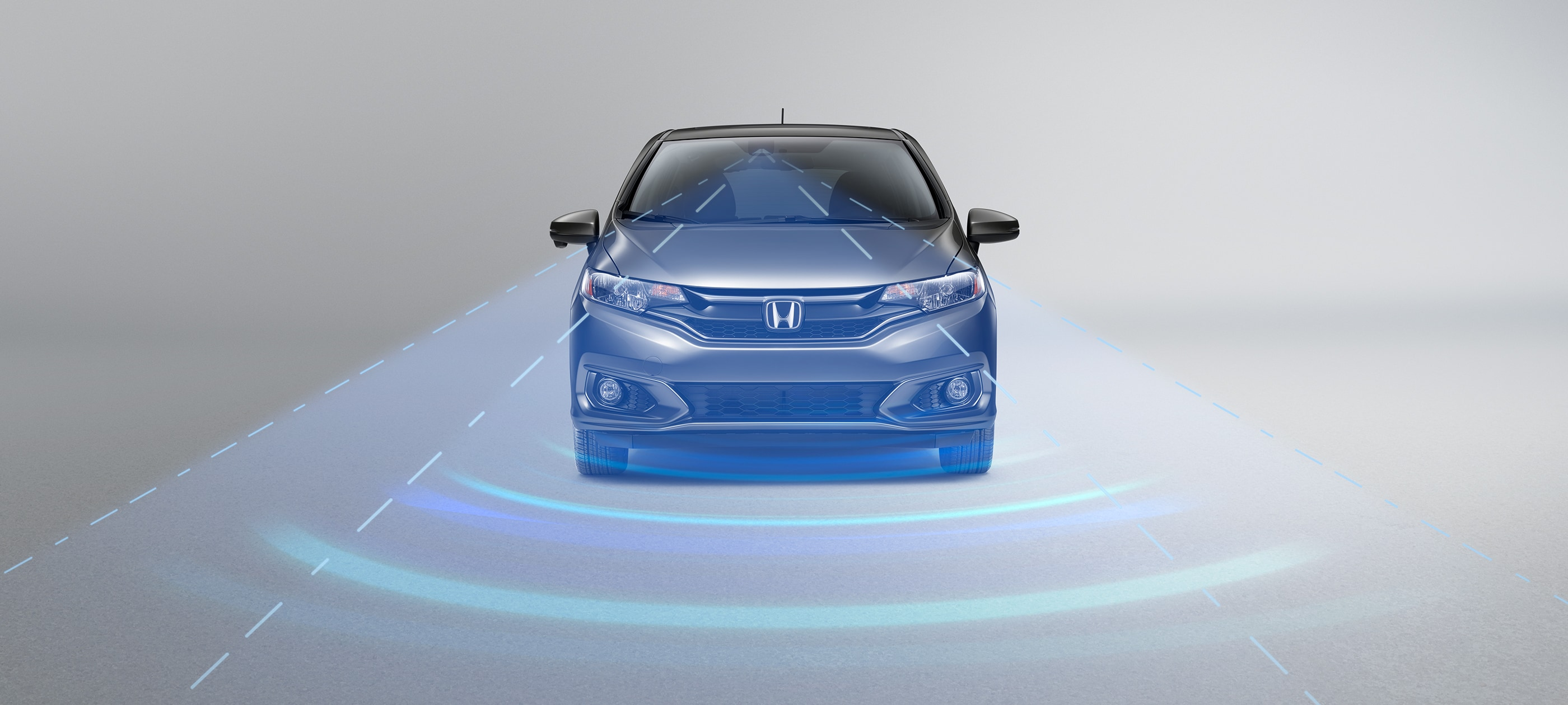 Front view of 2019 Honda Fit Sport CVT in Modern Steel Metallic with Honda Sensing® illustrated demonstration.