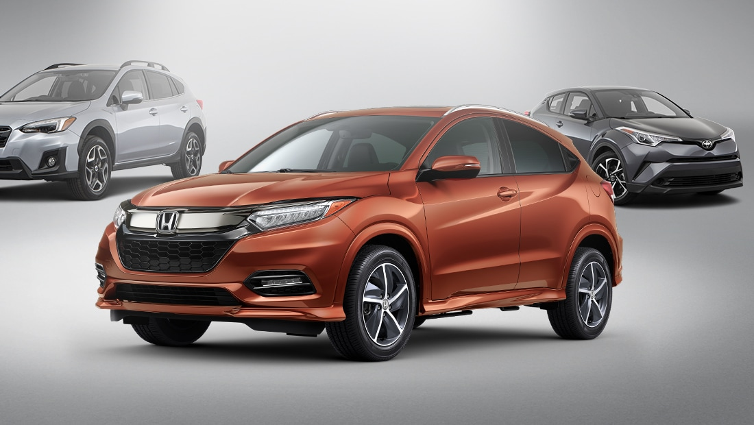 Front 3/4 driver's side view of the Honda HR-V in Orangeburst Metallic parked in front of competitor's vehicles