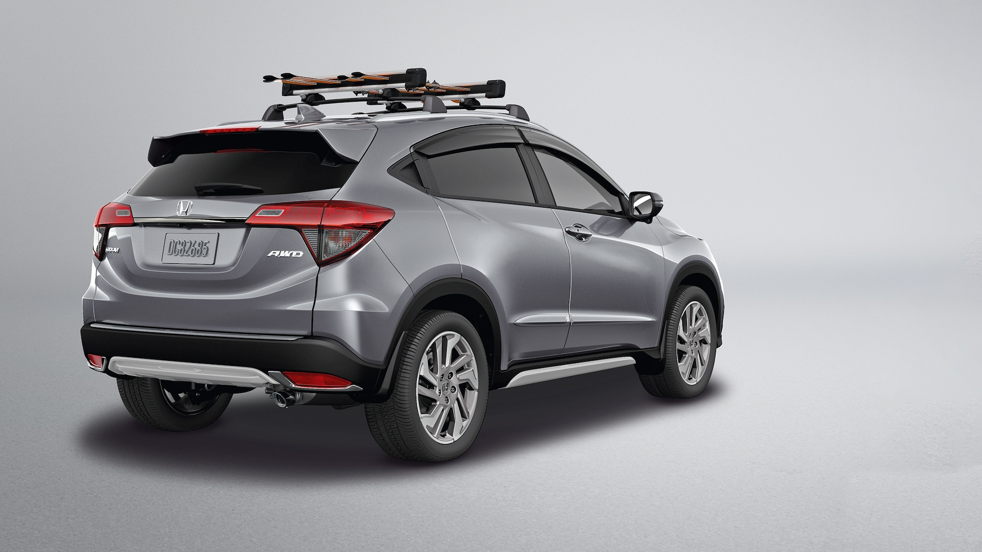 Rear 3/4 passenger's side view of the 2019 Honda HR-V EX in Lunar Silver Metallic with Honda Genuine Accessories.