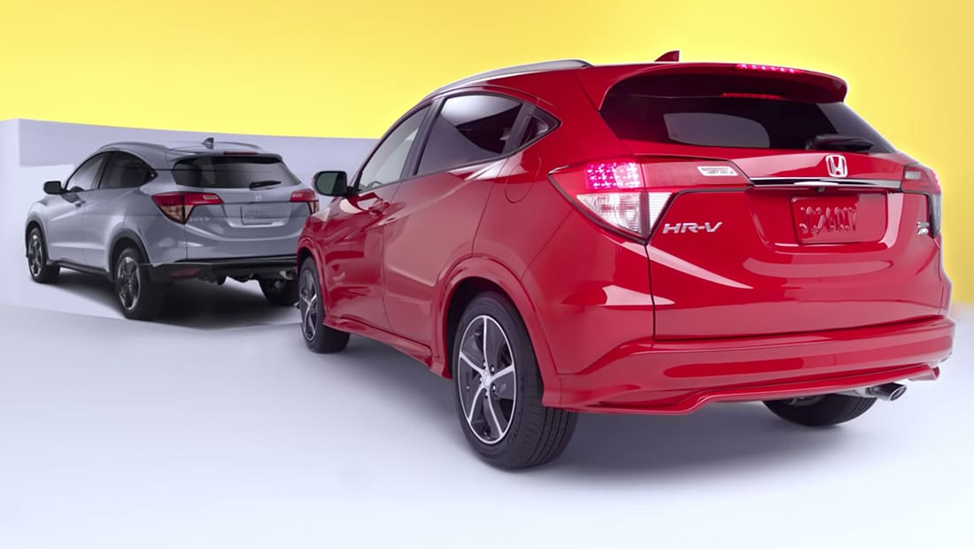 Rear 3/4 driver's side view of the 2019 Honda HR-V's in Modern Steel Metallic and Orangeburst Metallic.