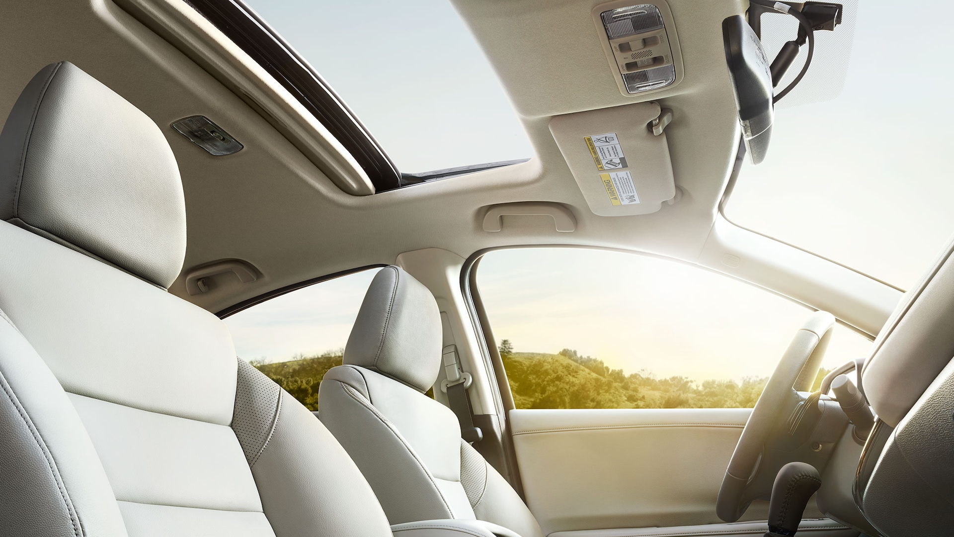 Passenger side view of open moonroof detail on the 2019 Honda HR-V EX-L in Gray Leather.