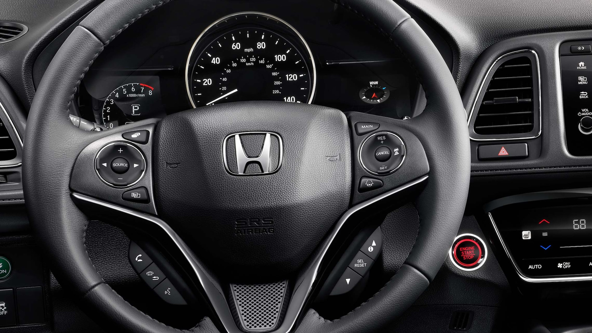 Steering wheel and dashboard detail in the 2019 Honda HR-V Touring in Black Leather.