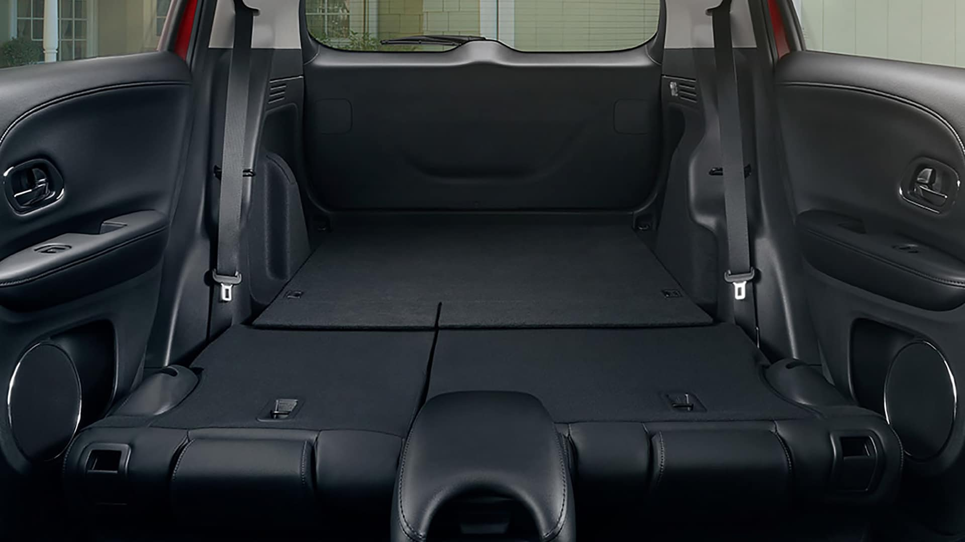 Interior view of the 2019 Honda HR-V Touring in Black Leather and all rear seats folded down.