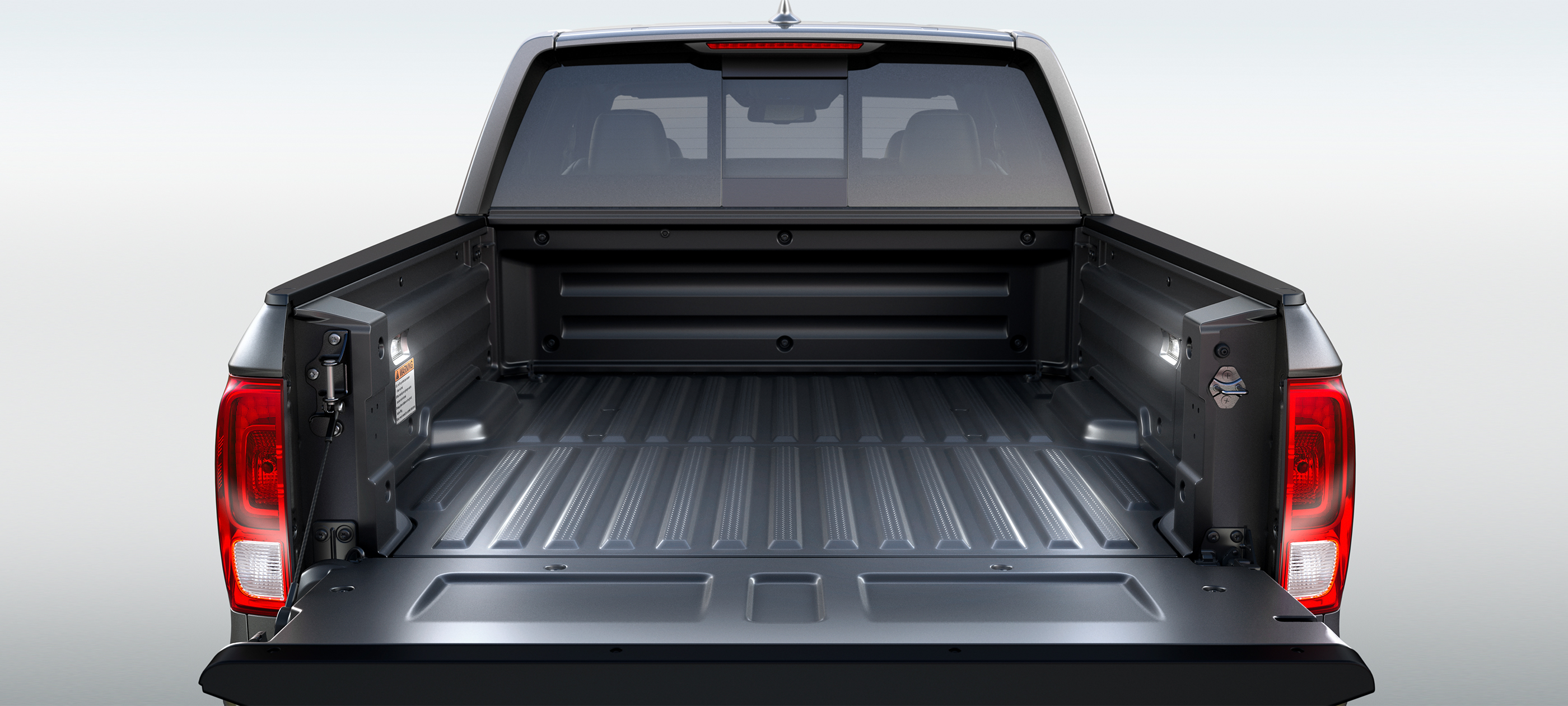 In bed lighting detail on 2019 Honda Ridgeline RTL-E in Modern Steel Metallic.