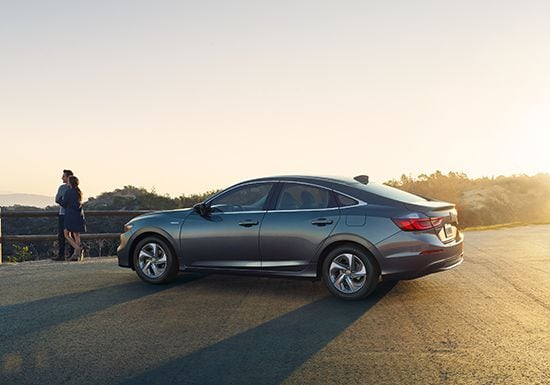 Side 7/8 rear profile of the 2019 Insight Touring in Modern Steel Metallic