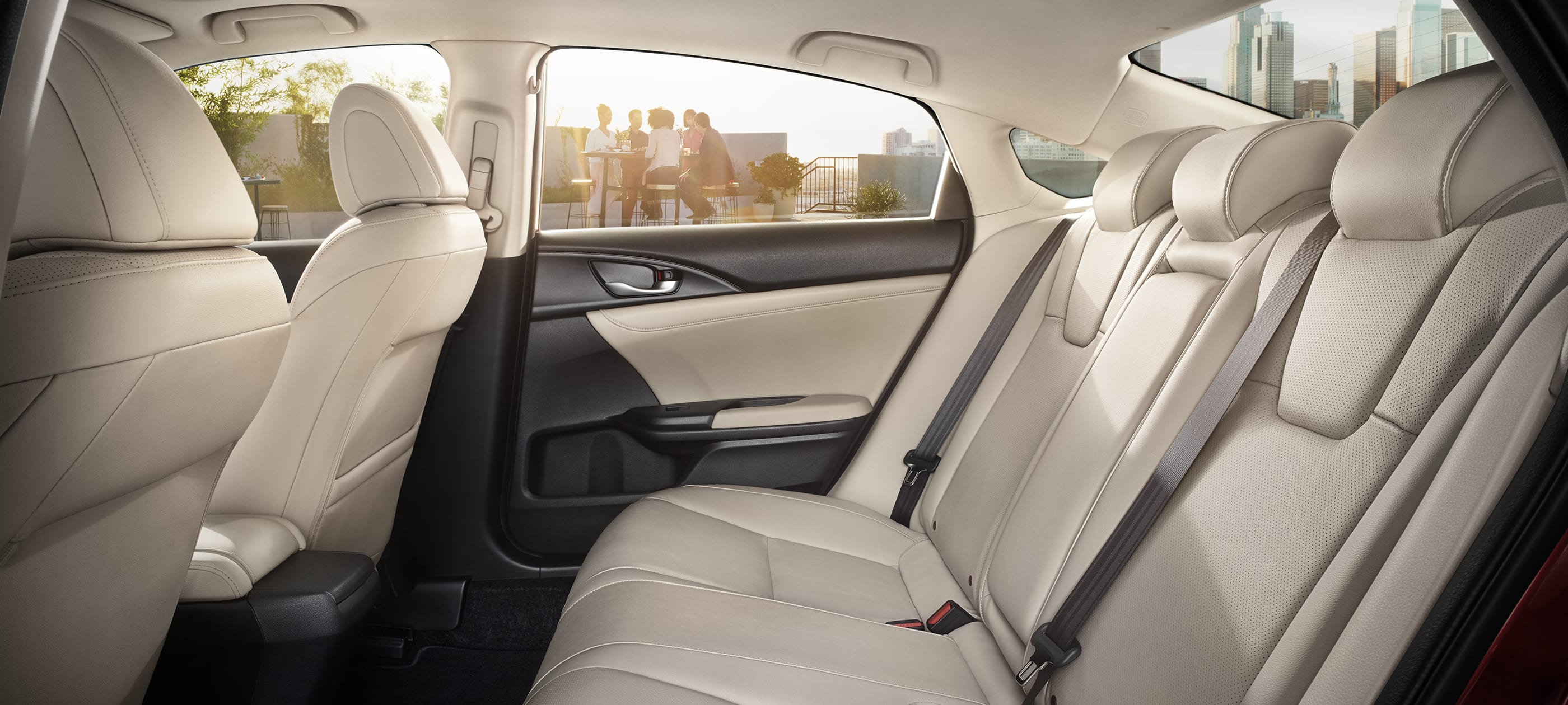 Interior driver-side profile view of rear seats in 2019 Honda Insight EX with beige interior.