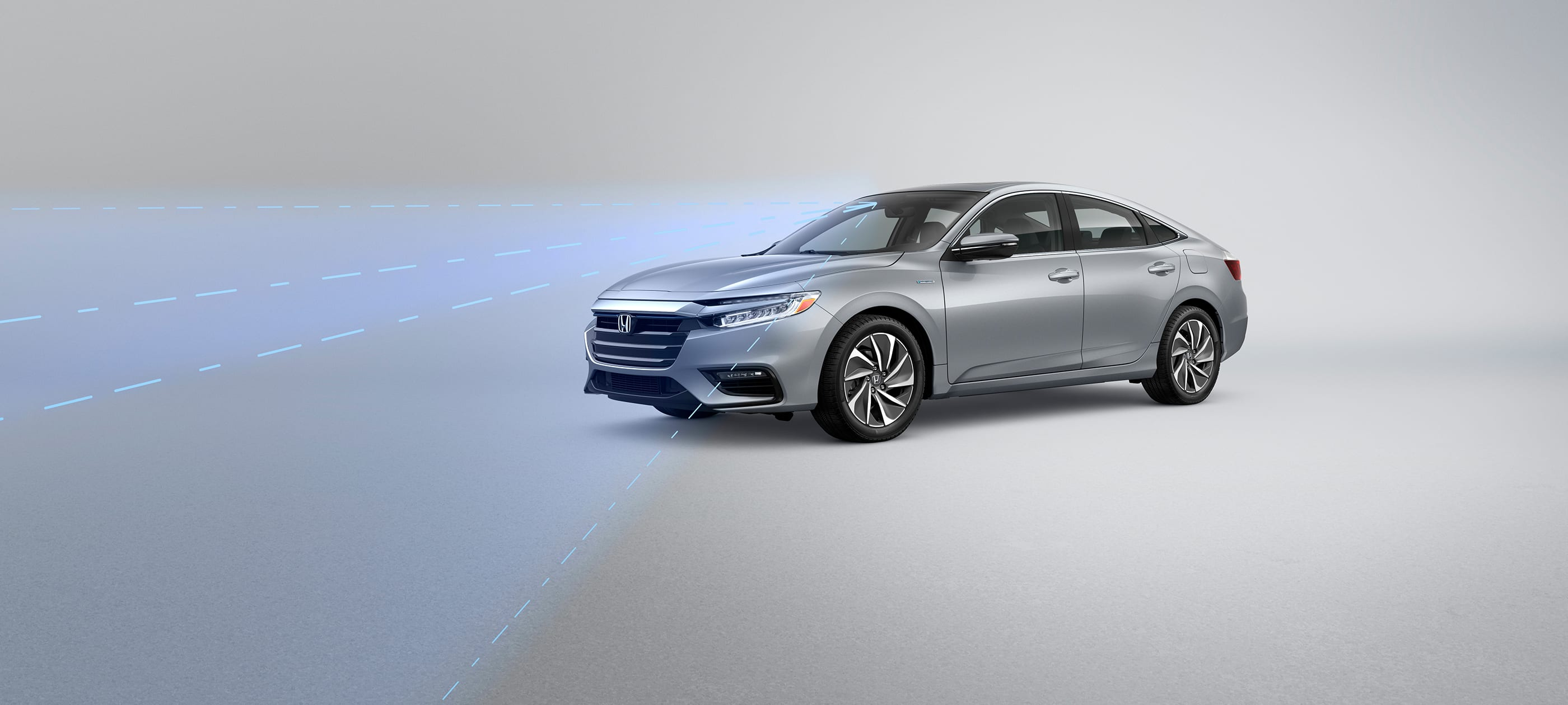 Front driver-side view of the 2020 Honda Insight Touring in Lunar Silver Metallic with illustrated Honda Sensing® graphics demonstrating Road Departure Mitigation System feature.