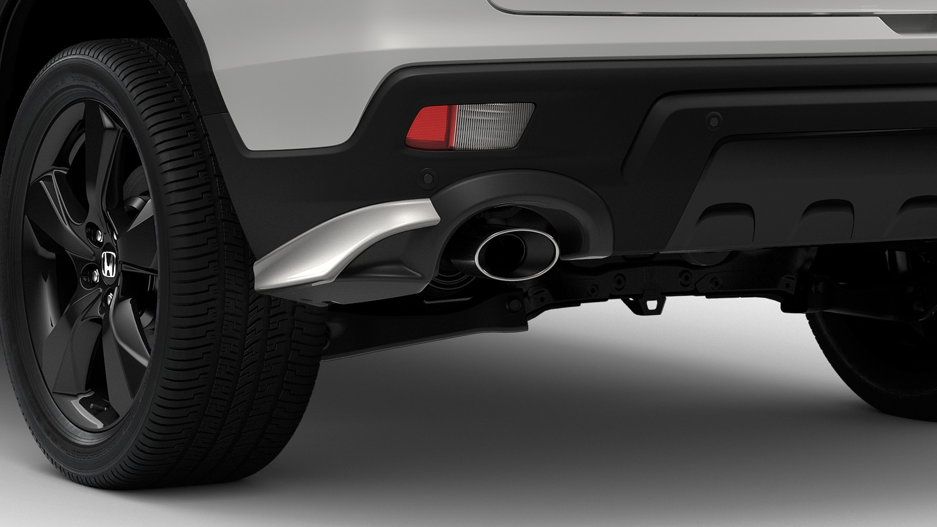 Detail of accessory rear underbody spoiler on the 2019 Honda Passport.