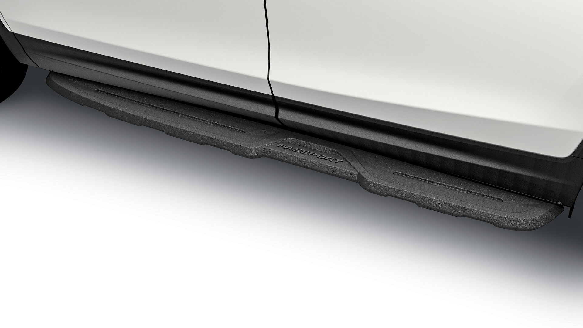 Detail of accessory die-cast running board on the 2019 Honda Passport.