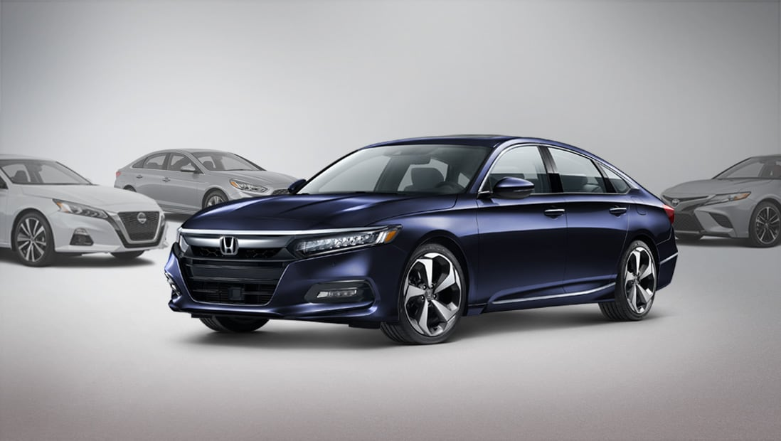2020 Honda Accord Touring 2.0T parked centered between two competitor vehicles.