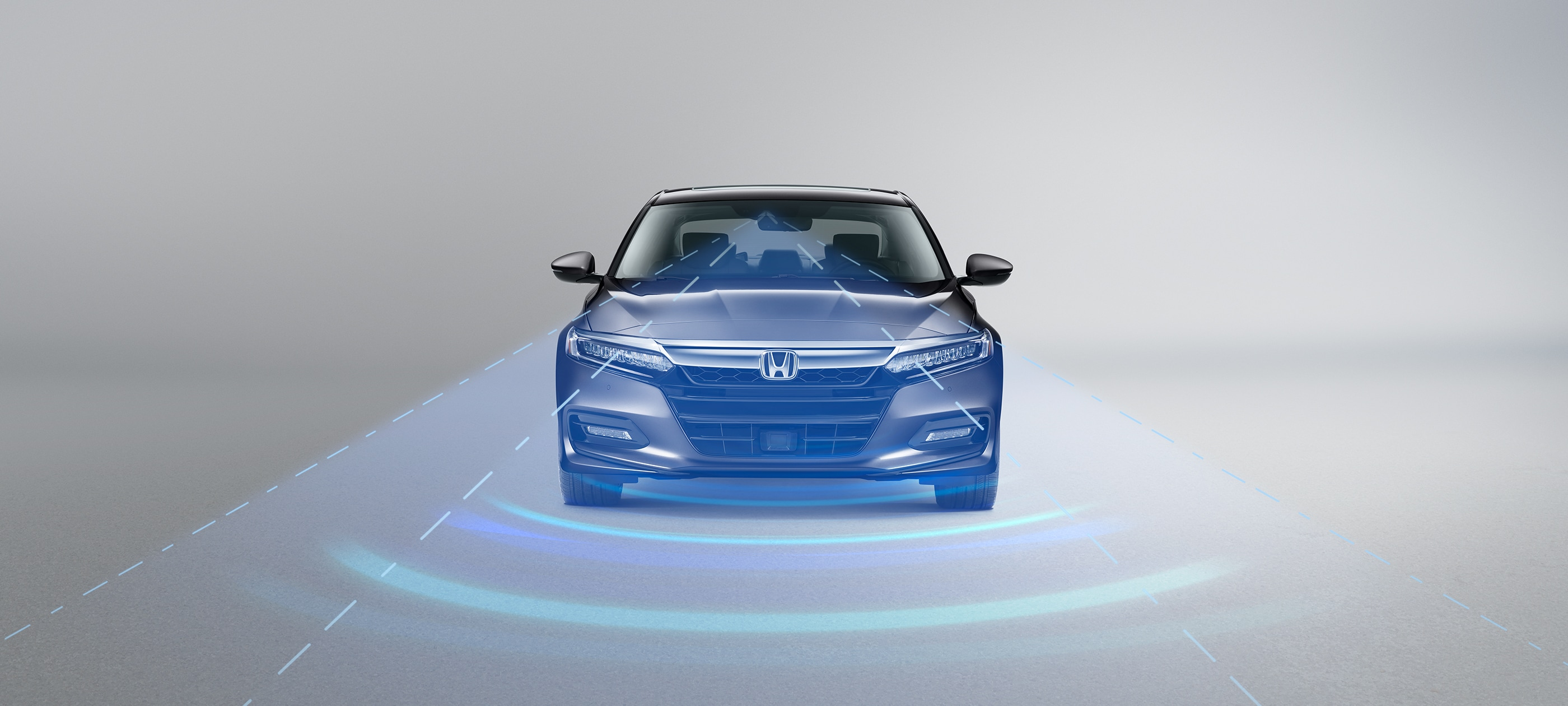 Rear view of the 2020 Honda Accord in Modern Steel Metallic with Honda Sensing® illustrated graphic.