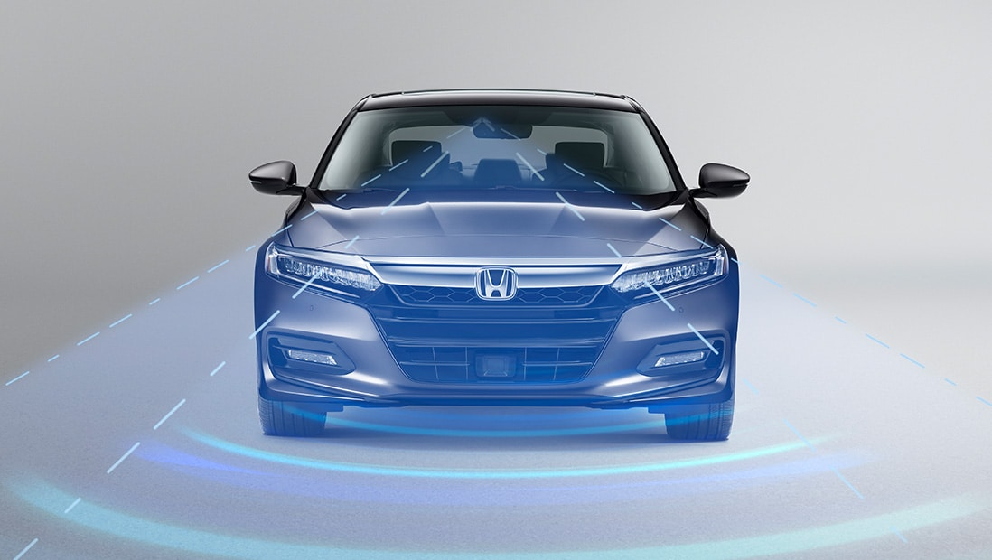 Demonstration of Honda Sensing® features. Plays video. Opens a dialog.