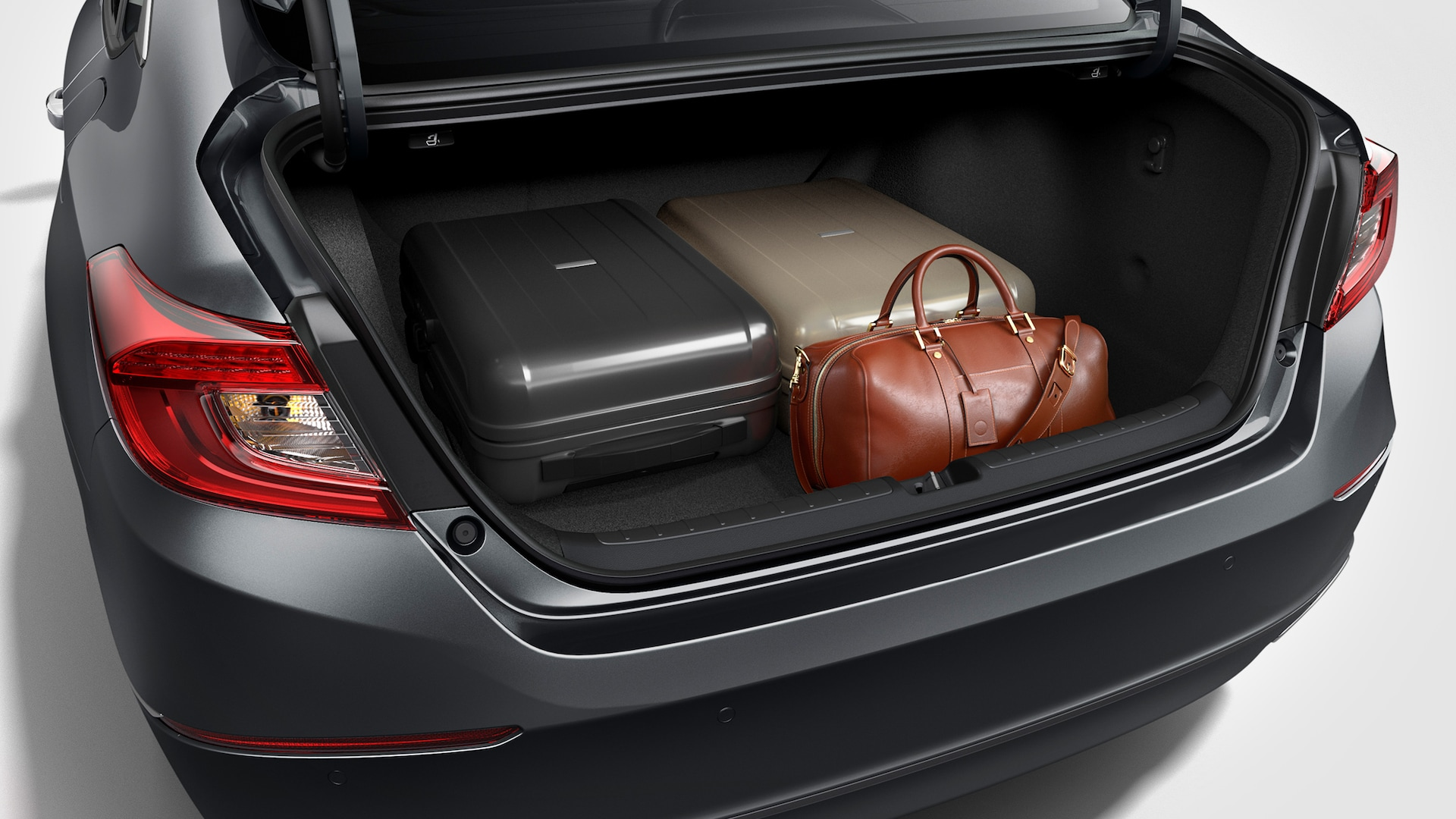 Open trunk detail with variety of cargo loaded inside the 2020 Honda Accord Touring 2.0T.