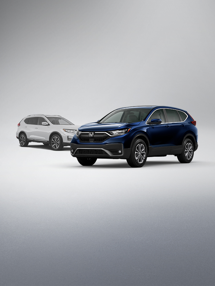 Front driver-side view of the 2020 Honda CR-V EX in Obsidian Blue Pearl shown parked in front of a competitor vehicle.