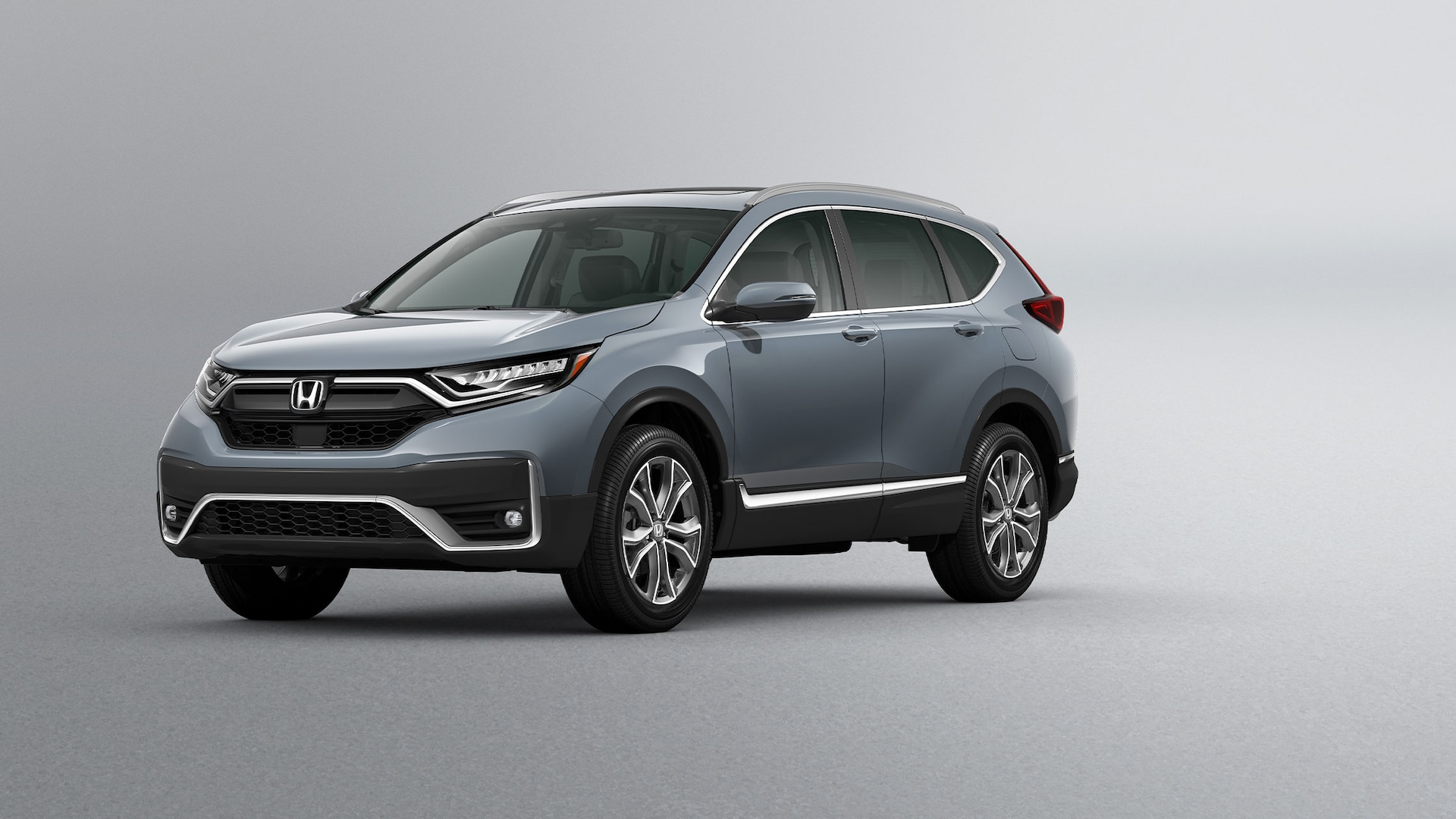 Front 3/4 driver-side view of 2020 Honda CR-V Touring in Sonic Gray Pearl.