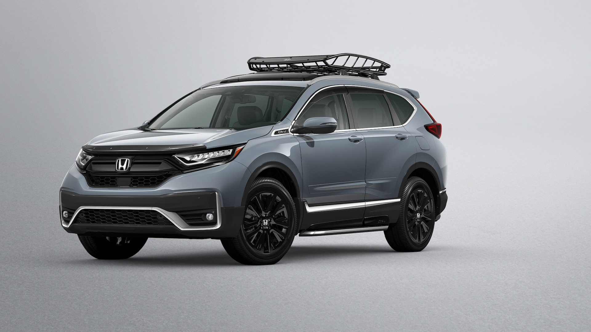 Front ¾ driver-side view of 2020 Honda CR-V in Sonic Gray Pearl shown with Honda Genuine Accessories.