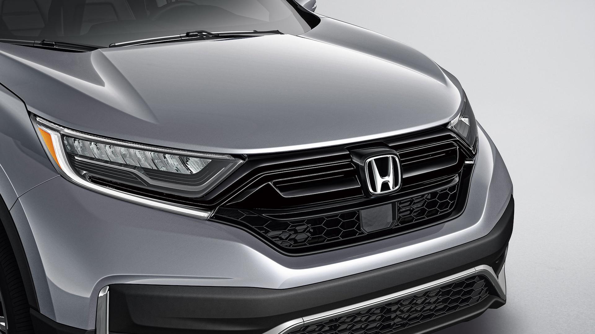 Detail of accessory gloss-black grille on the 2020 Honda CR-V.