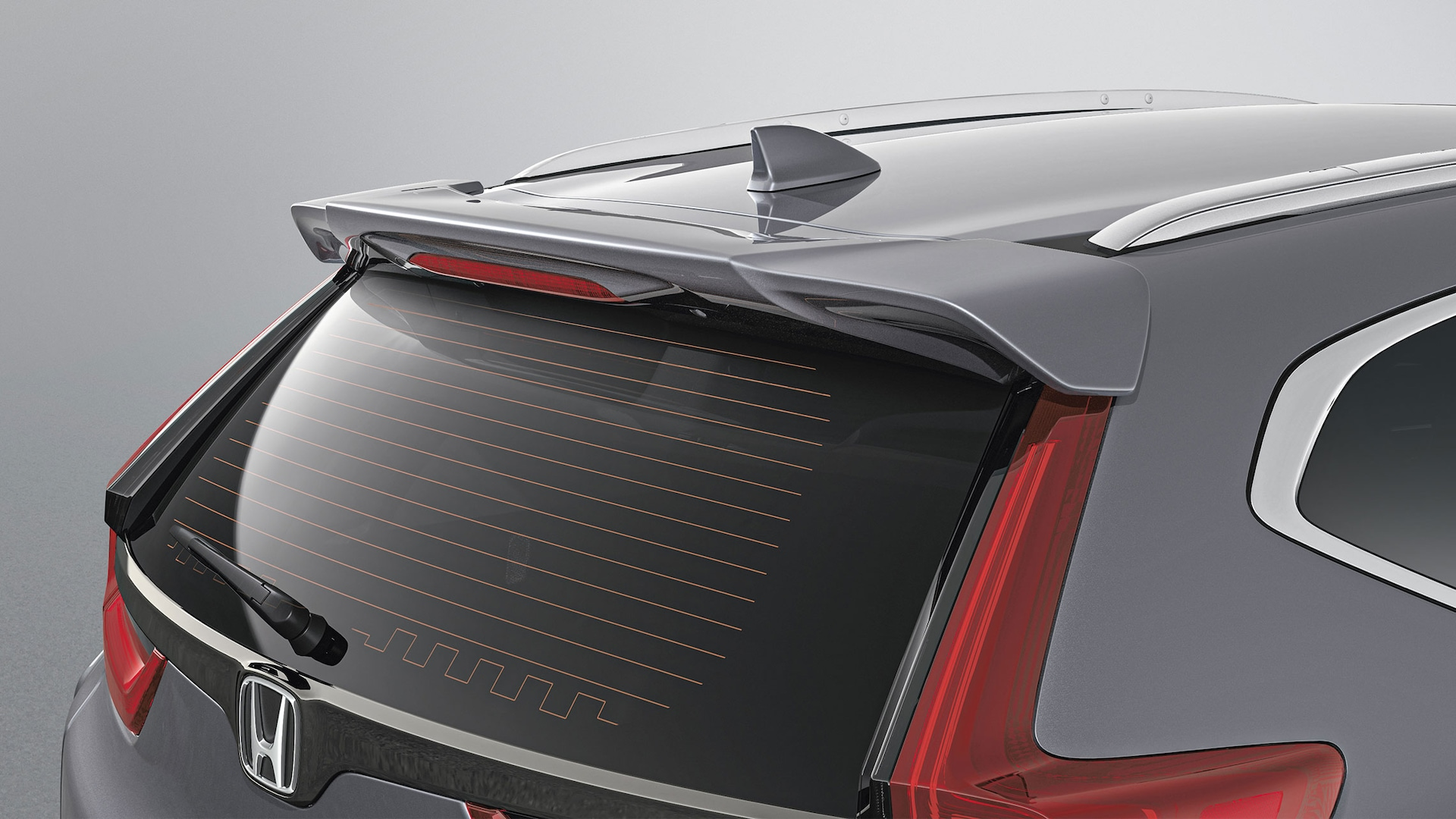 Detail of accessory tailgate spoiler on the 2020 Honda CR-V.